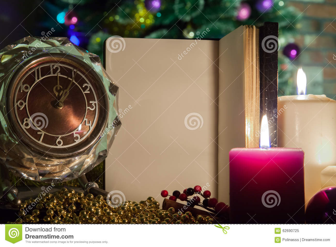 Christmas Greetings On An Open Notebook With A Clock And A Candle In