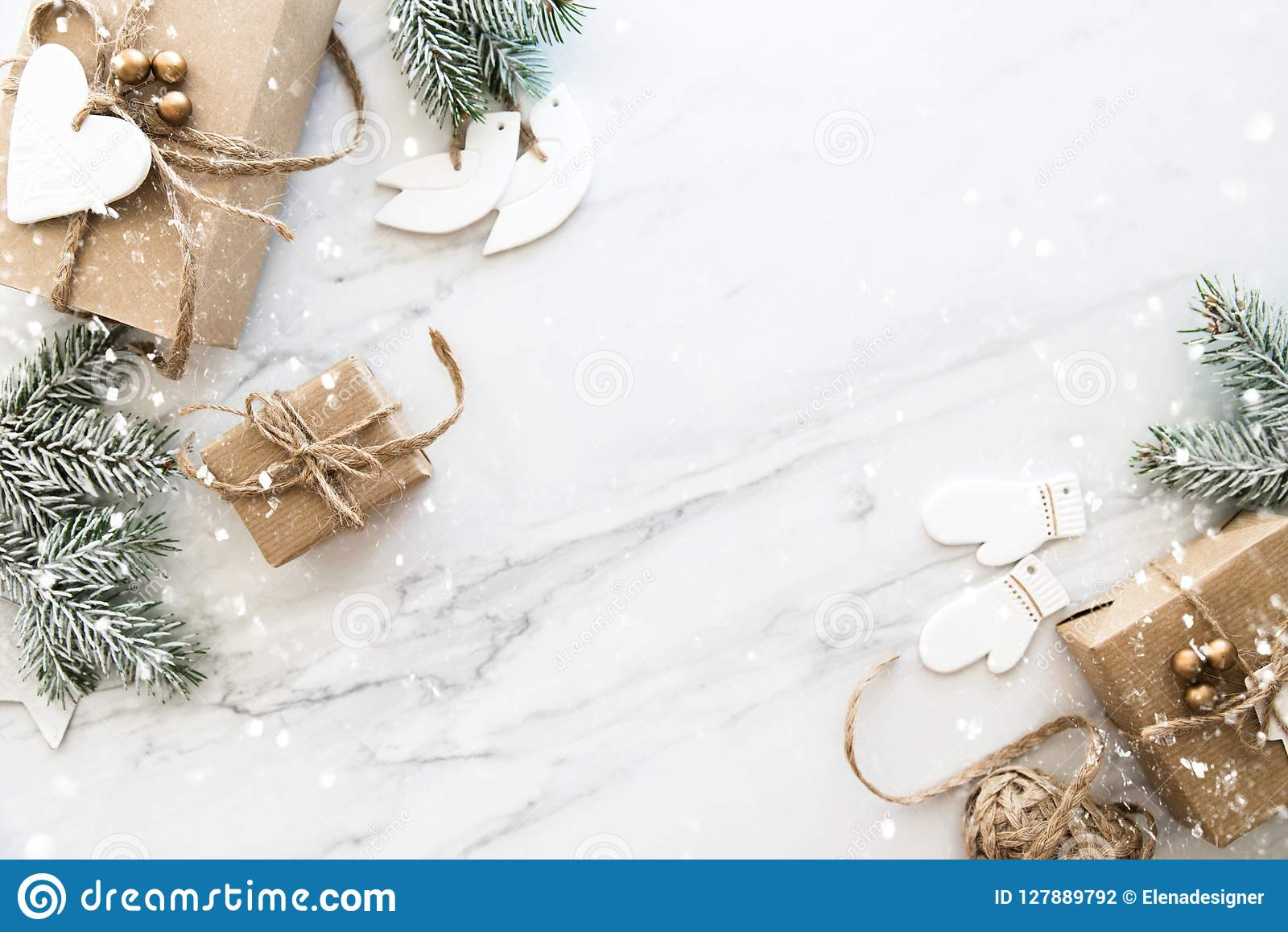 Merry Christmas Background.Christmas Handmade Gift Boxes On White Marble Background Top