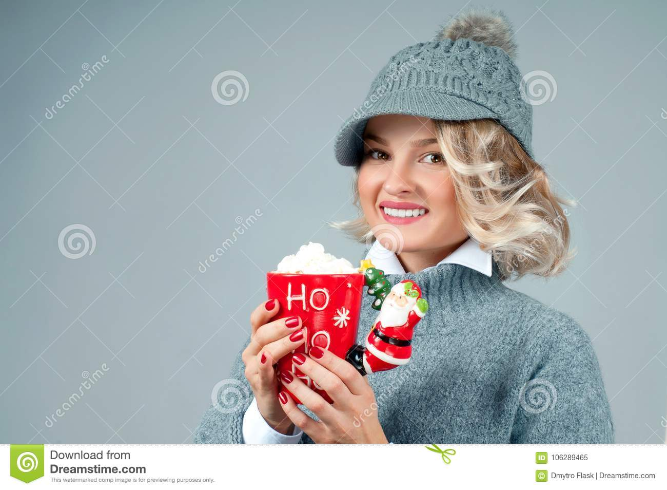 f11e07277af Christmas And New Year. Woman In Knitted Hat Is Holding Cup Of ...