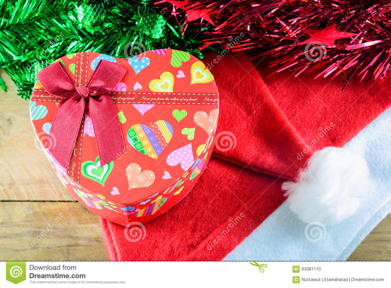Christmas Heart Gift Box And Decorations On Wooden