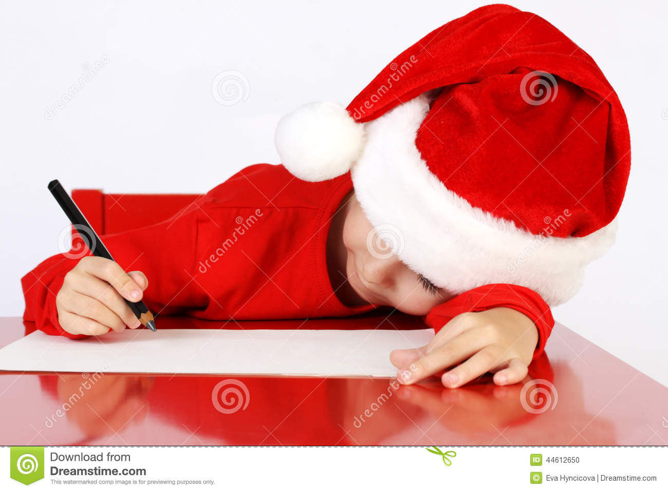 christmas helper child writing letter to santa cla stock photo