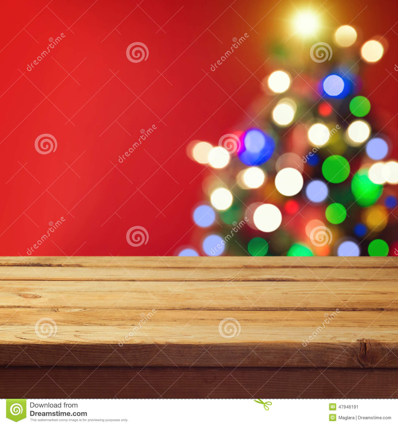 Christmas holiday background with empty wooden deck table over Christmas tree bokeh. Ready for product montage