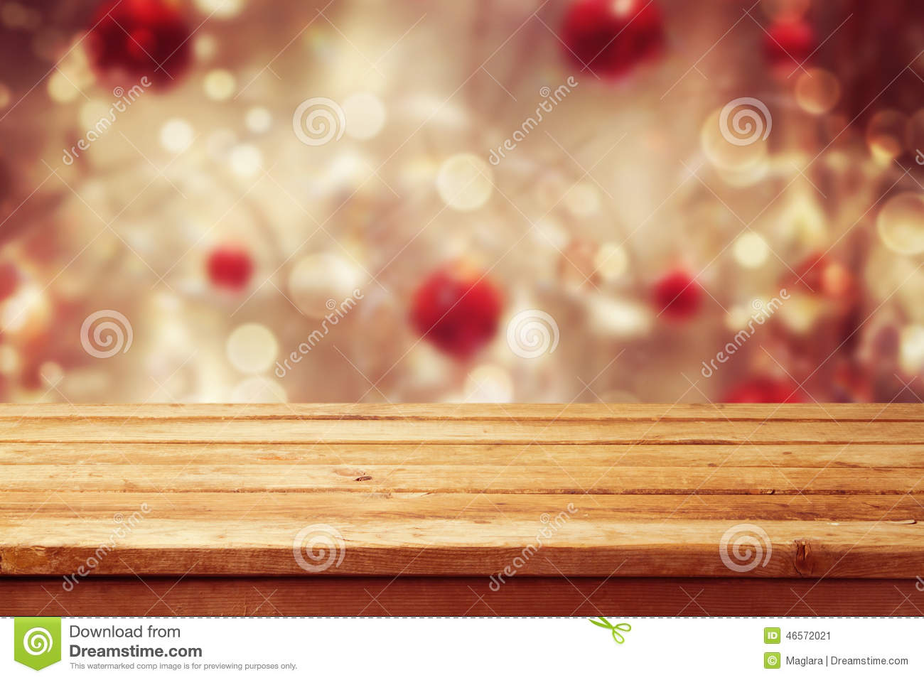 Christmas holiday background with empty wooden deck table over winter bokeh. Ready for product montage