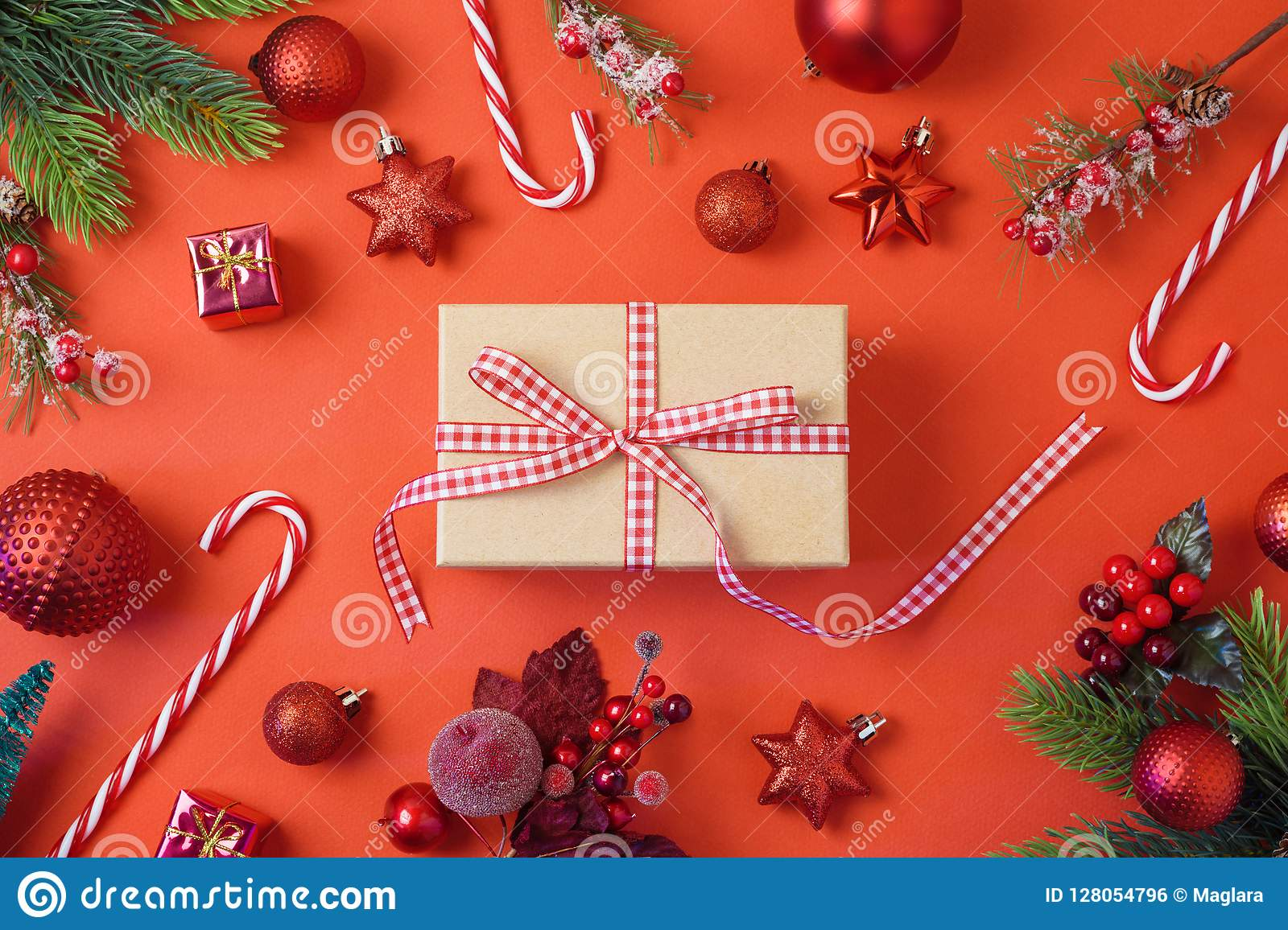 Christmas holiday background with gift box, decorations and orna
