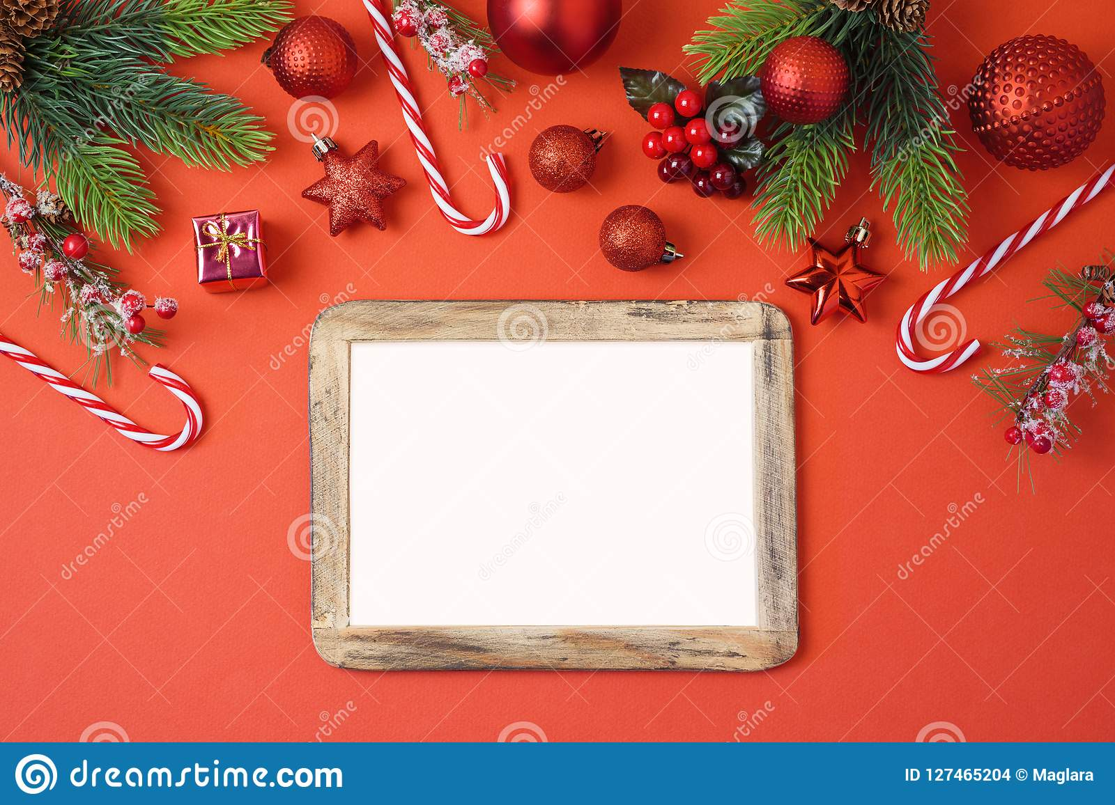 Christmas holiday background with photo frame, decorations and o