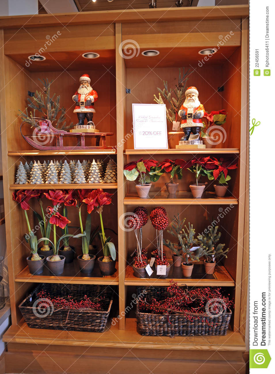 Display of Christmas home decorations including Santa Claus, sled