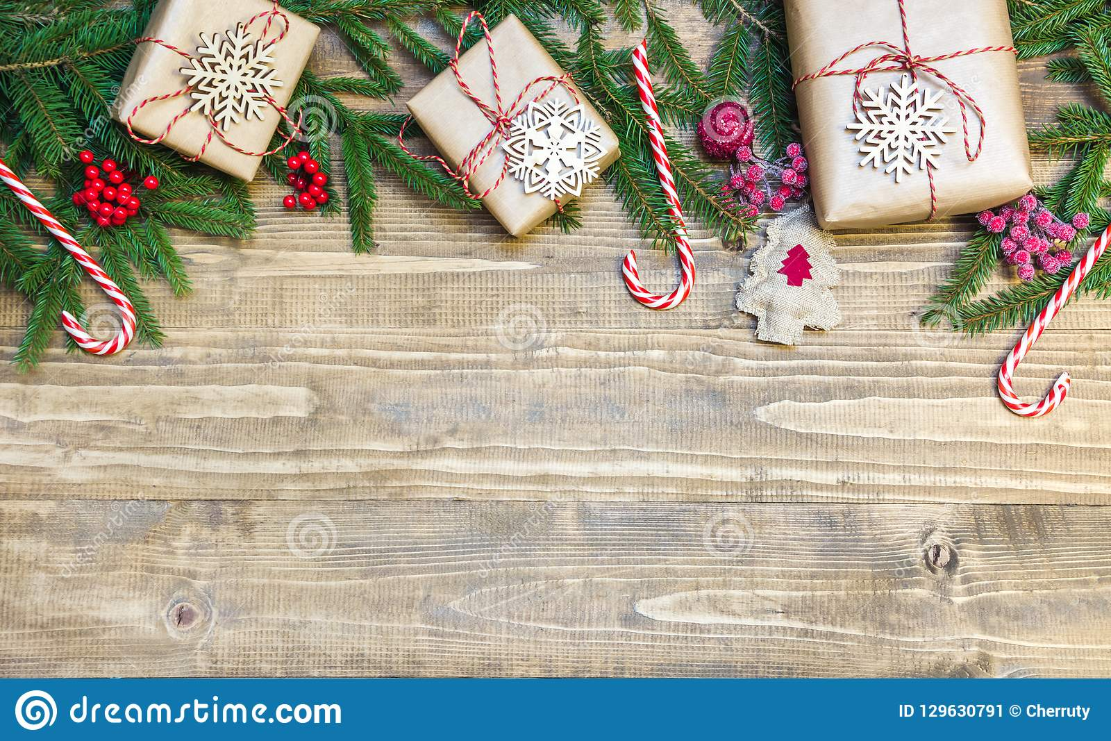 christmas holiday border  gifts holly berries and