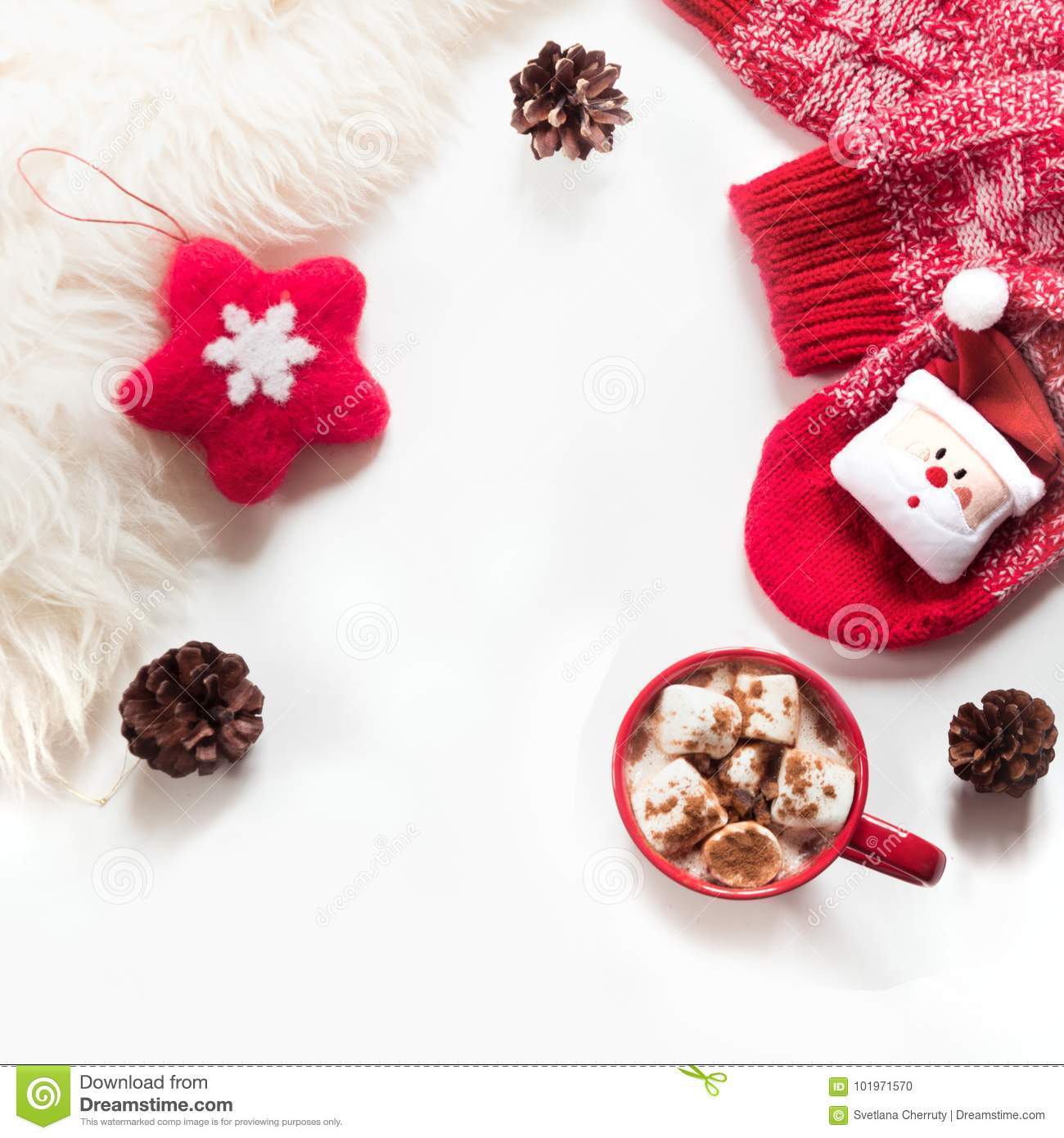 Christmas holiday hot chocolate with marshmallow, cone, white fur, red felt star, knitted socks on white background.