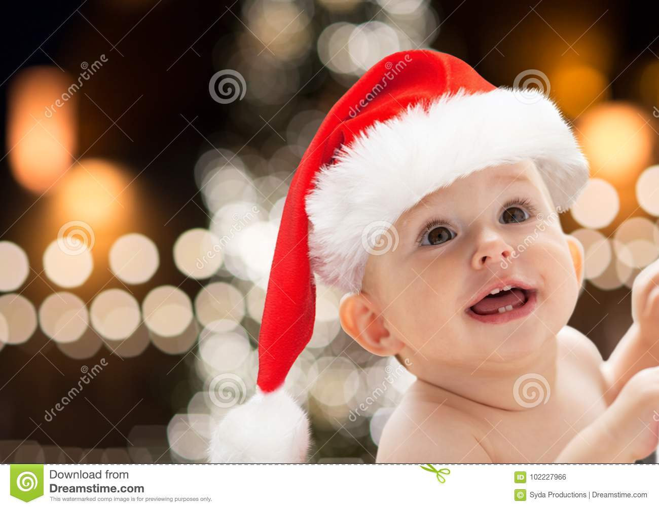 c2684eab56828 Close Up Of Little Baby In Santa Hat At Christmas Stock Photo ...