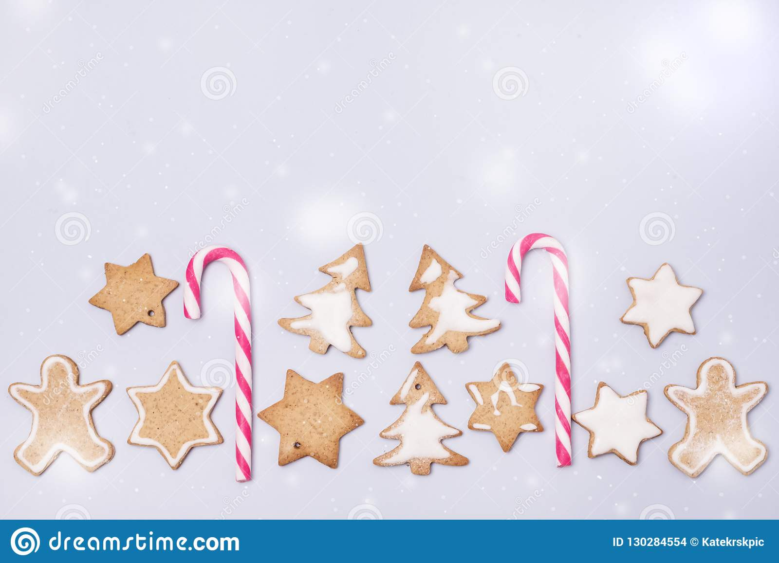 Christmas Homemade Gingerbread Cookies on Light Blue Background Flat Lay Holidays Concept Christmas Background Copy Space Horizont