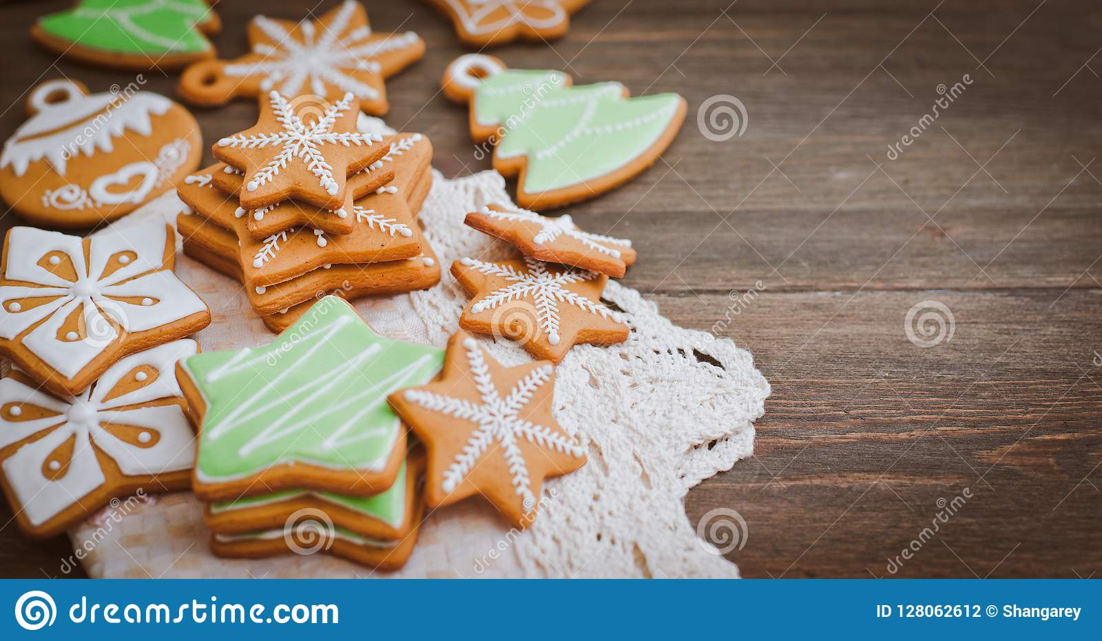 Christmas homemade gingerbread house cookie wooden background