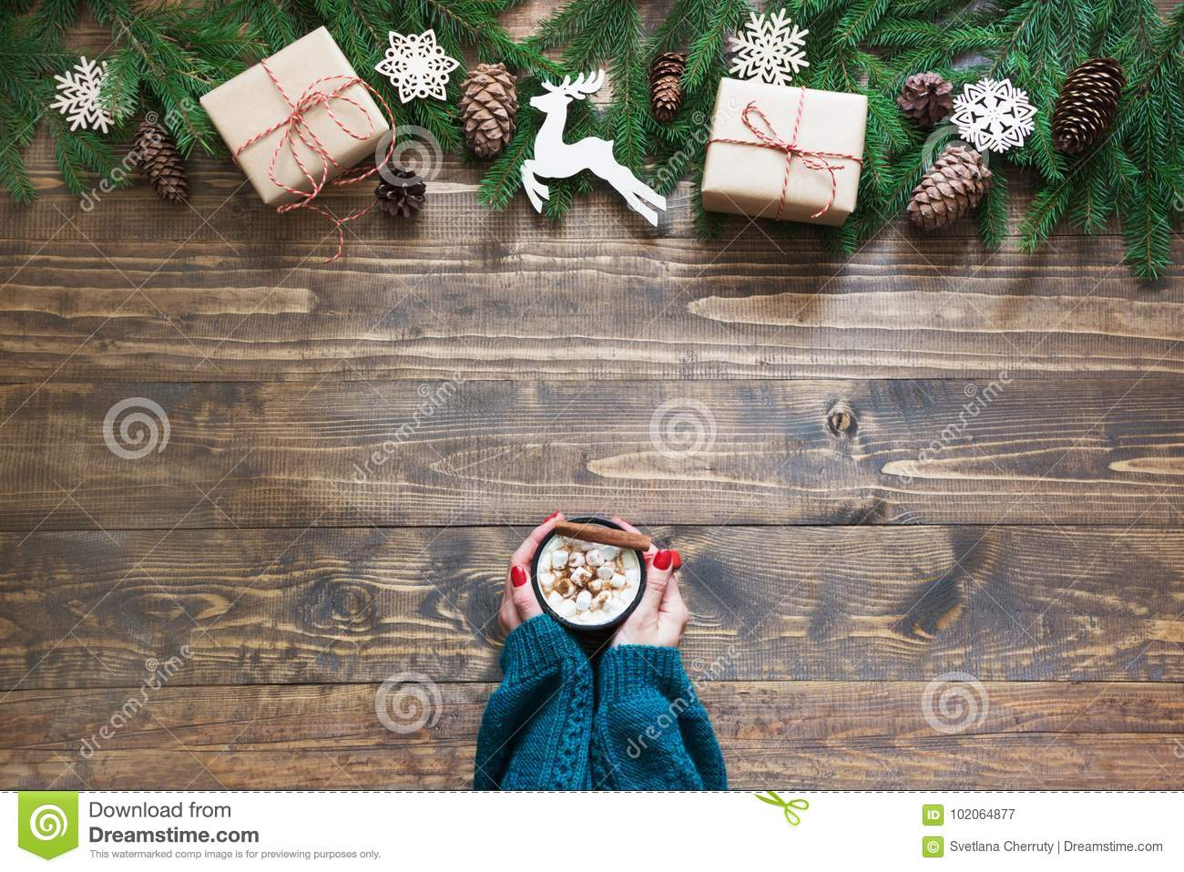 Christmas Hot Chocolate In Female Hand On The Wooden