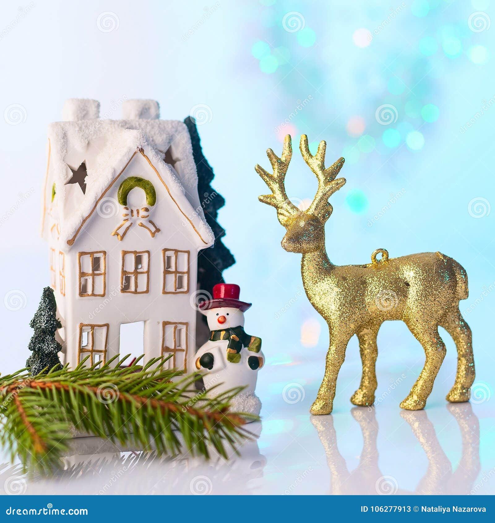 Christmas House And Reindeer With Bokeh Lights Stock Image