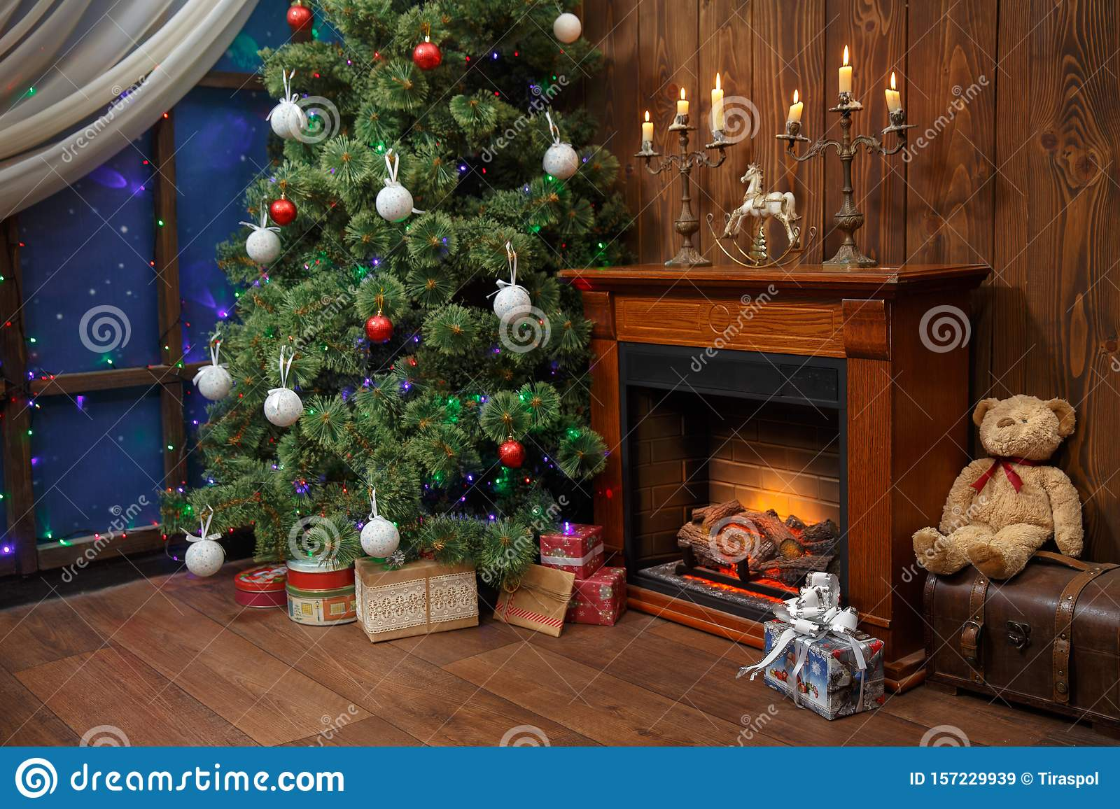 Christmas Interior With Toys And Lots Of Candles Wooden Fake Fireplace Christmas Tree Boxes In Studio Stock Image Image Of Plaid Decoration 157229939