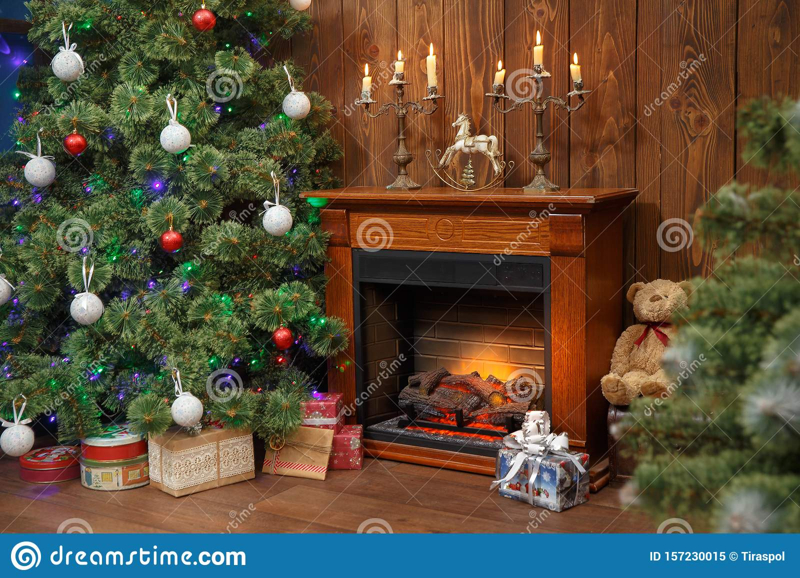 Christmas Interior With Toys And Lots Of Candles Wooden Fake Fireplace Christmas Tree Boxes In Studio Stock Image Image Of Decor Firewood 157230015