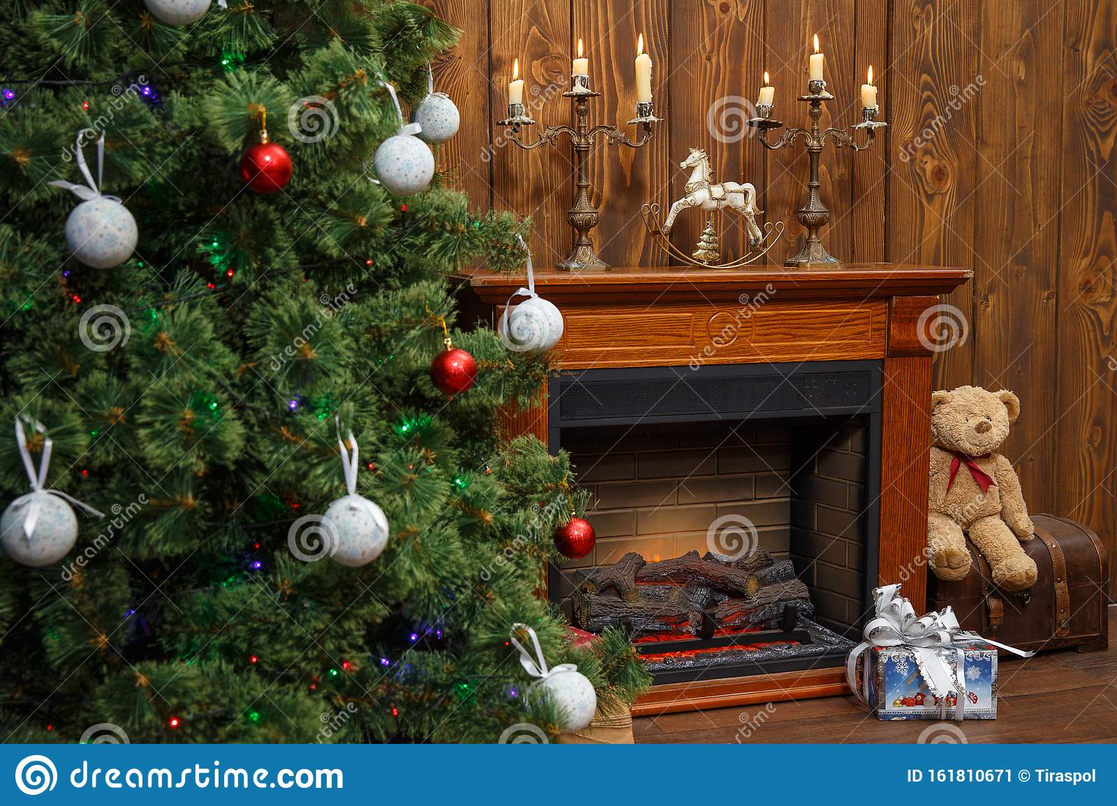 Christmas Interior With Toys And Lots Of Candles Wooden Fake Fireplace Christmas Tree Boxes In Studio Stock Image Image Of Fireplace Illuminated 161810671