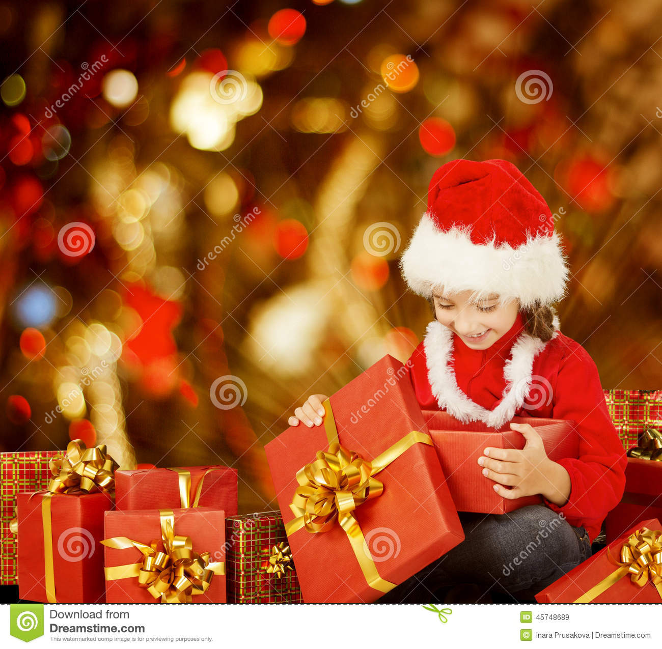 christmas kid opening present gift box happy child in