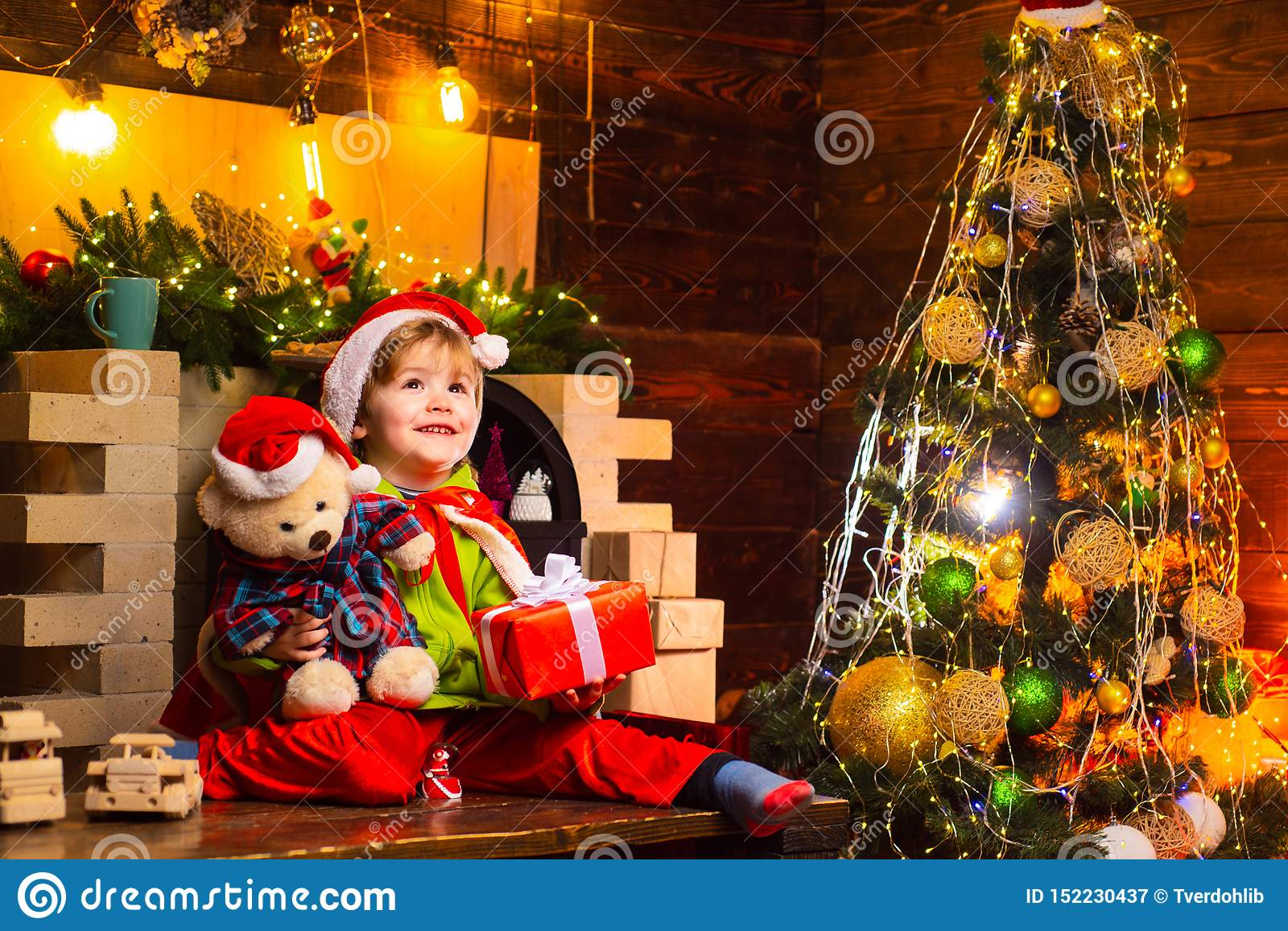 Christmas kids - happiness concept. A young male is playing and laughing. Children joyful emotions. Close-ended and Open