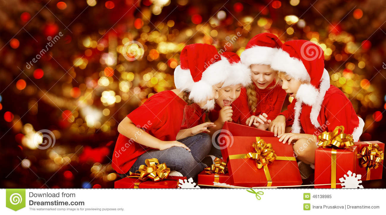 Christmas Kids Opening Present Gift Box, Children In Santa Hat Stock ...