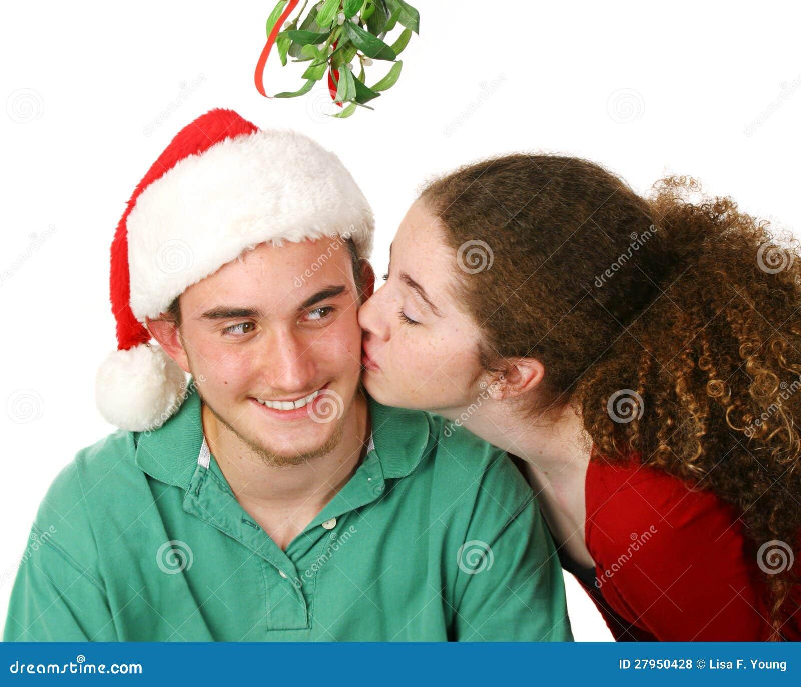 Christmas Kiss Under Mistletoe Stock Photo - Image of looking, head ...