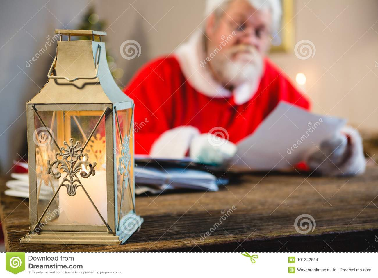 Christmas lantern and Santa Claus in background