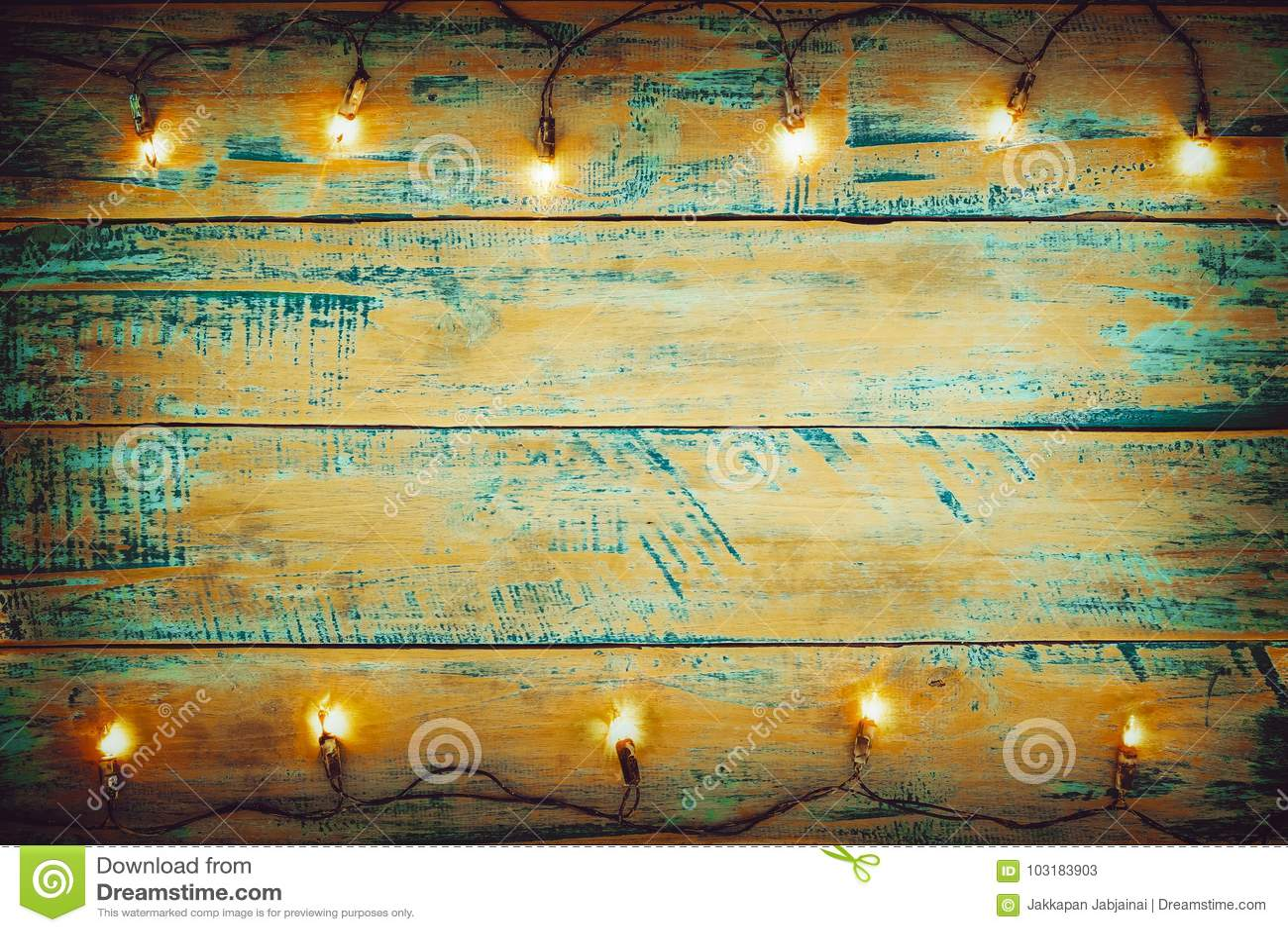 Christmas lights bulb on wood table. Merry christmas xmas background