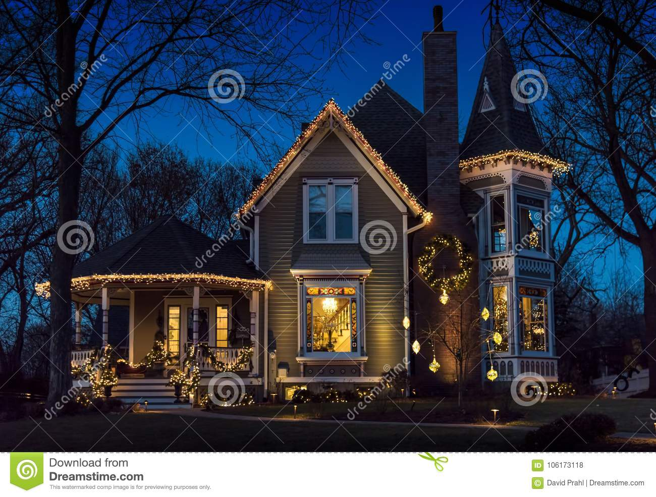 Exterior of victorian home decorated for christmas stock photo image of garand white 106173118 for Christmas lights for house exterior