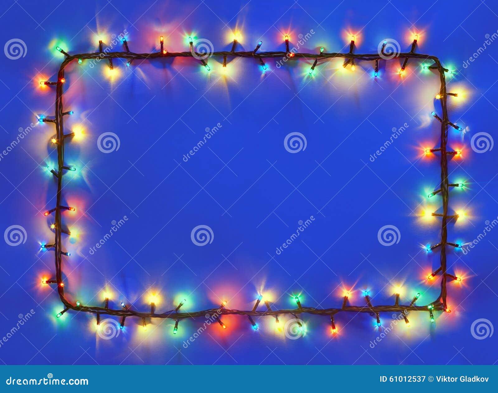 Christmas lights frame on dark blue background