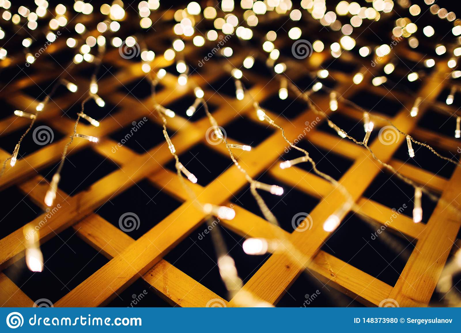 Christmas lights on house background texture in city