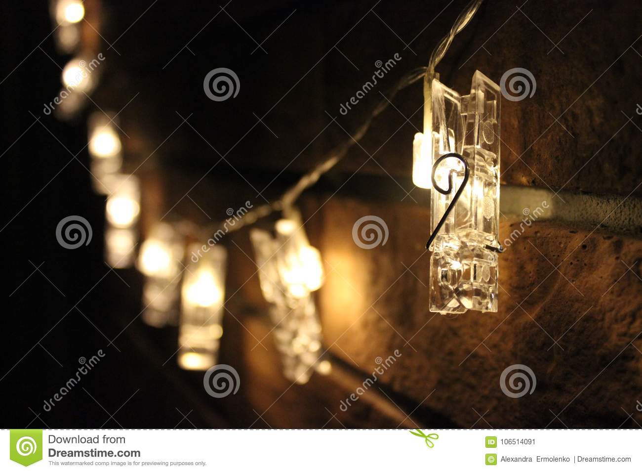 What Can I Use To Attach Christmas Lights To Brick christmas lights, lighted garland closeup stock image