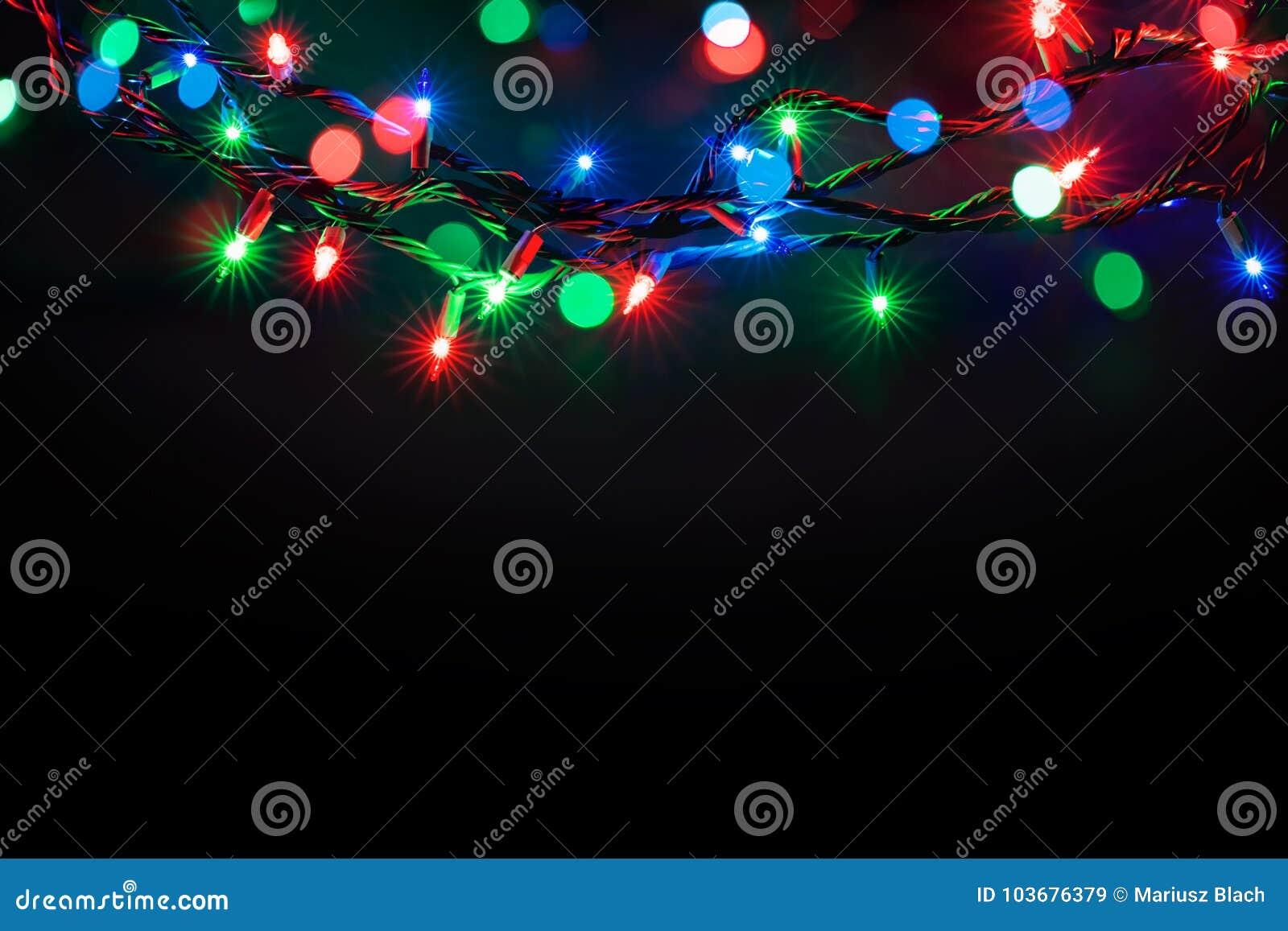 Christmas lights over black background