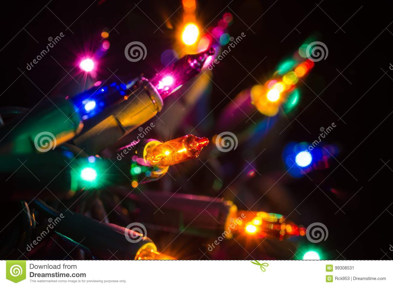 colored christmas lights shining in the darkness