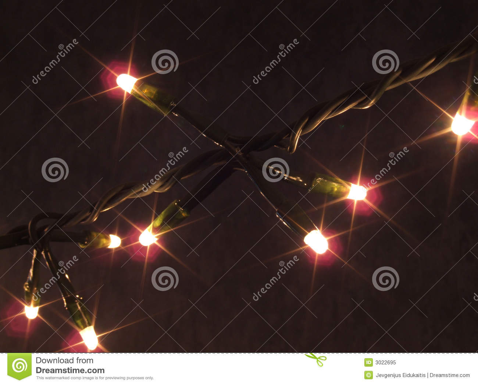 Christmas lights strand stock image of dark