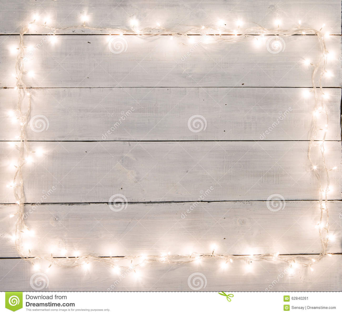 christmas lights on white painted wooden background with copy sp stock photo 62840261 megapixl