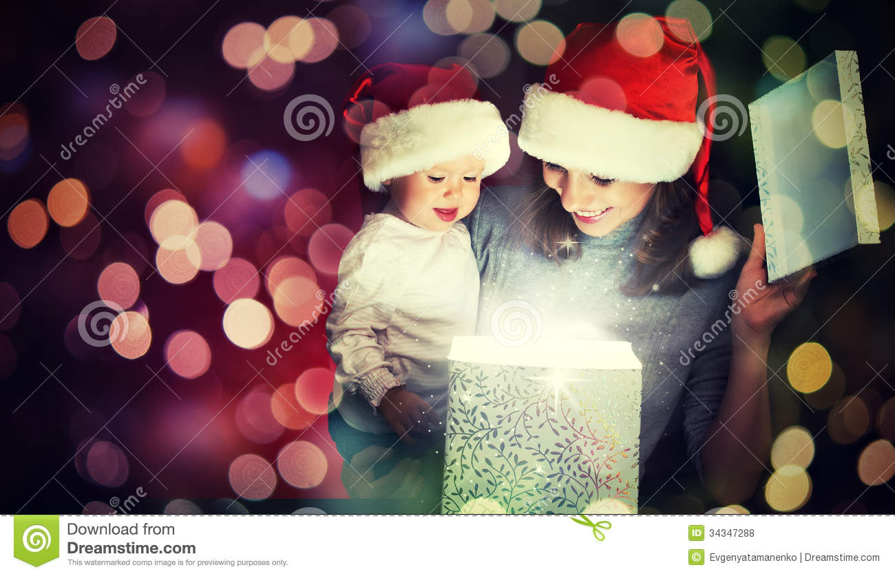 Mother And Baby Gift Box : Christmas magic gift box and a happy family mother