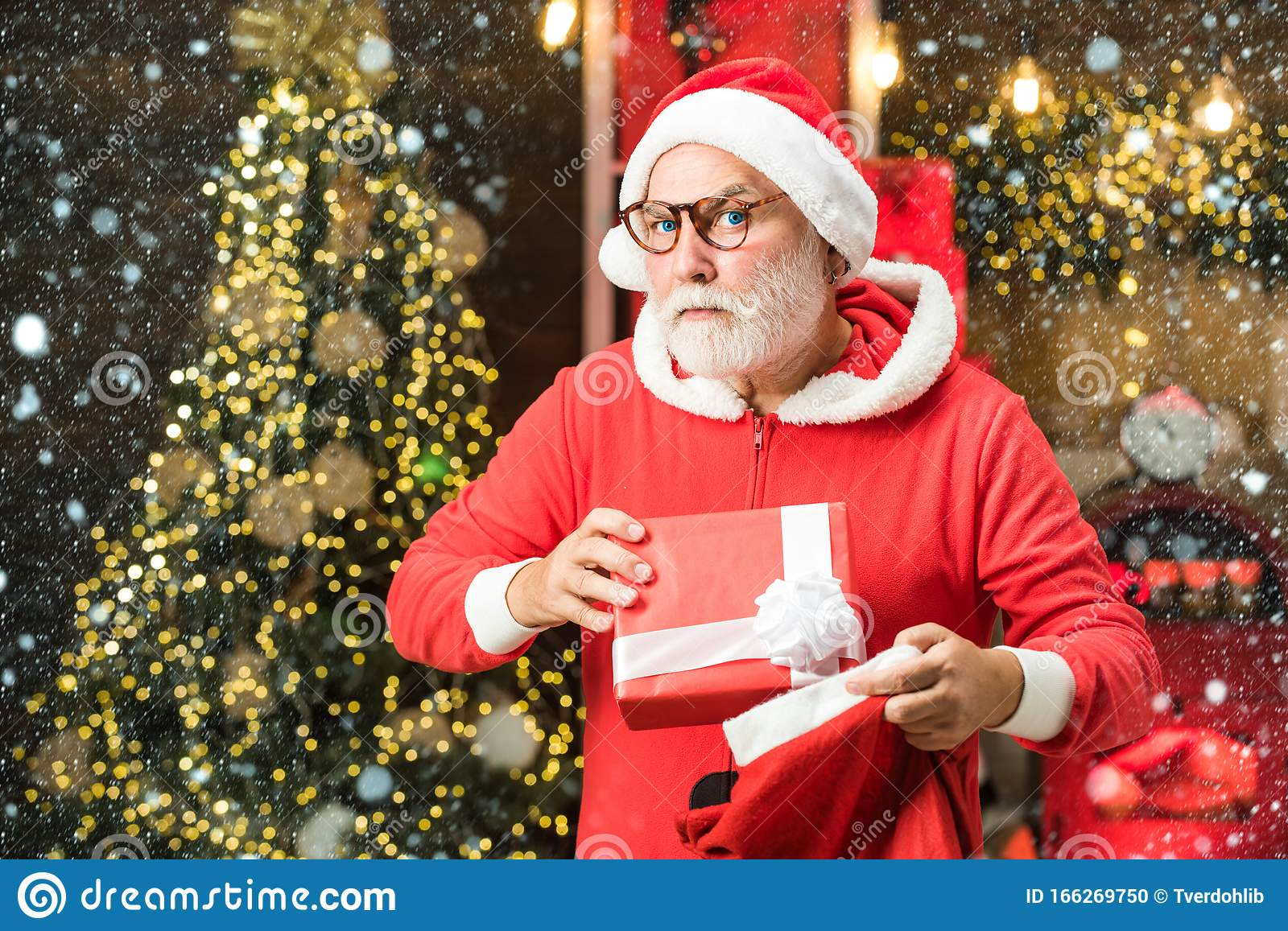Christmas Man In Snow Funny Santa Hold Christmas Gift Santa Wishes Merry Christmas Santa Grandfather With A White Stock Photo Image Of Beard Expressions 166269750