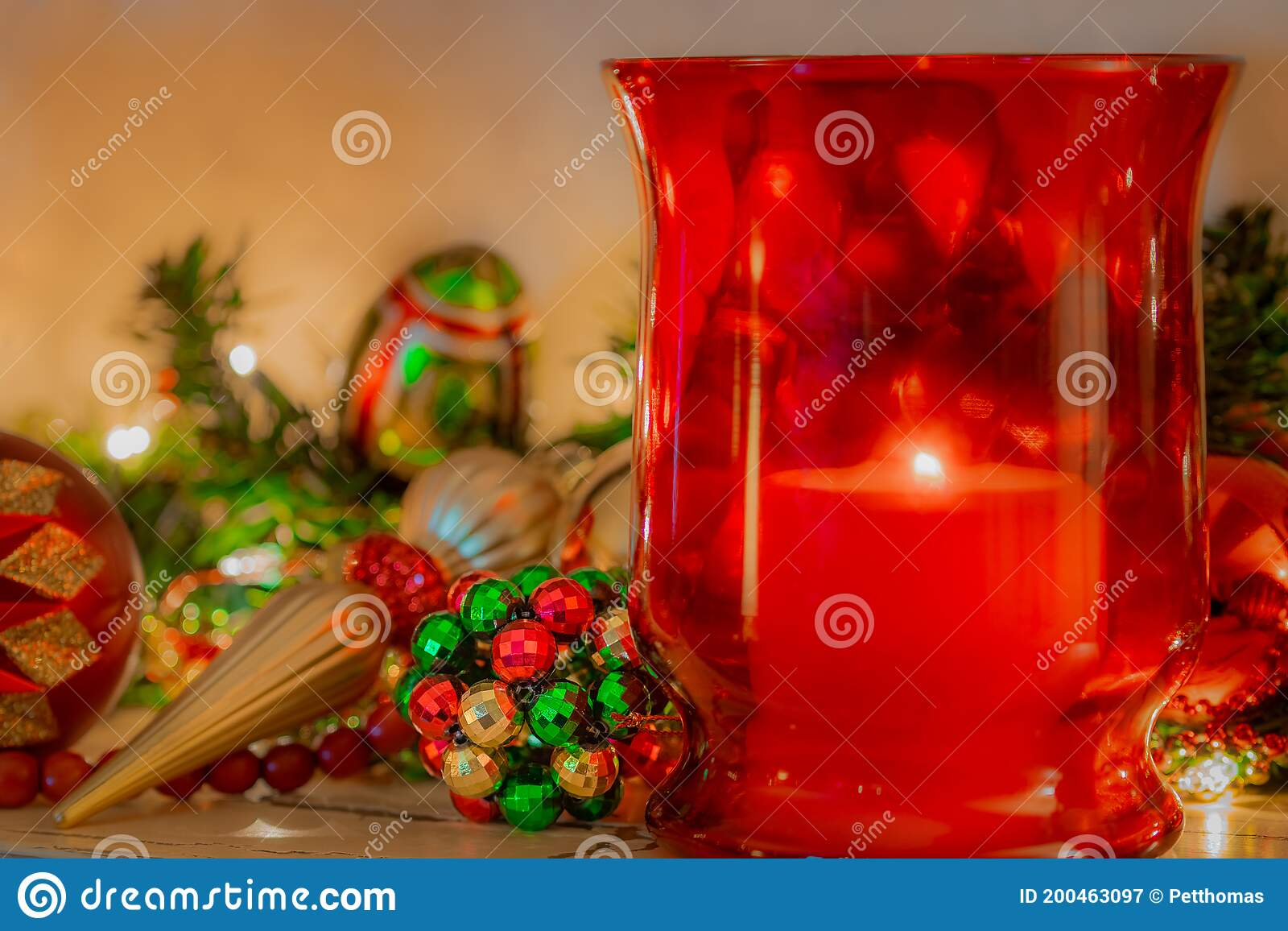 Christmas Mantelpiece With Red And Green Ornaments And Red Glass Candle Holder Stock Image Image Of Garland Glittering 200463097