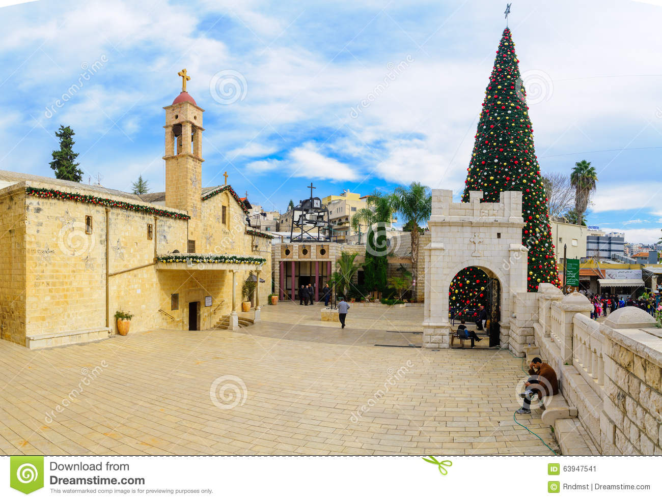 nazareth israel december 16 2015 scene of the greek orthodox church of the annunciation with a christmas tree locals and tourists in nazareth