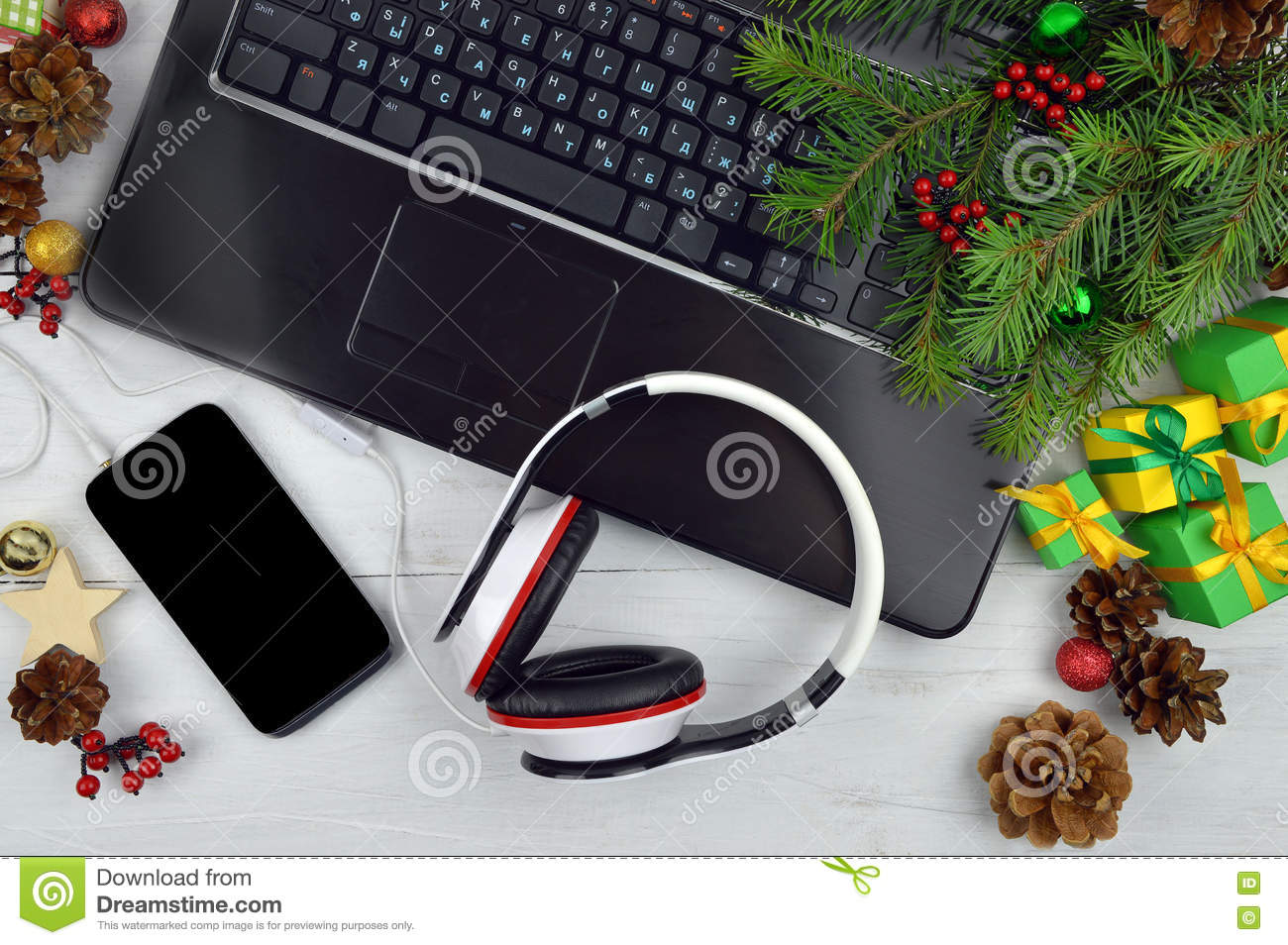 Christmas Melodiesartphone And Headphones On A Wooden Backgro