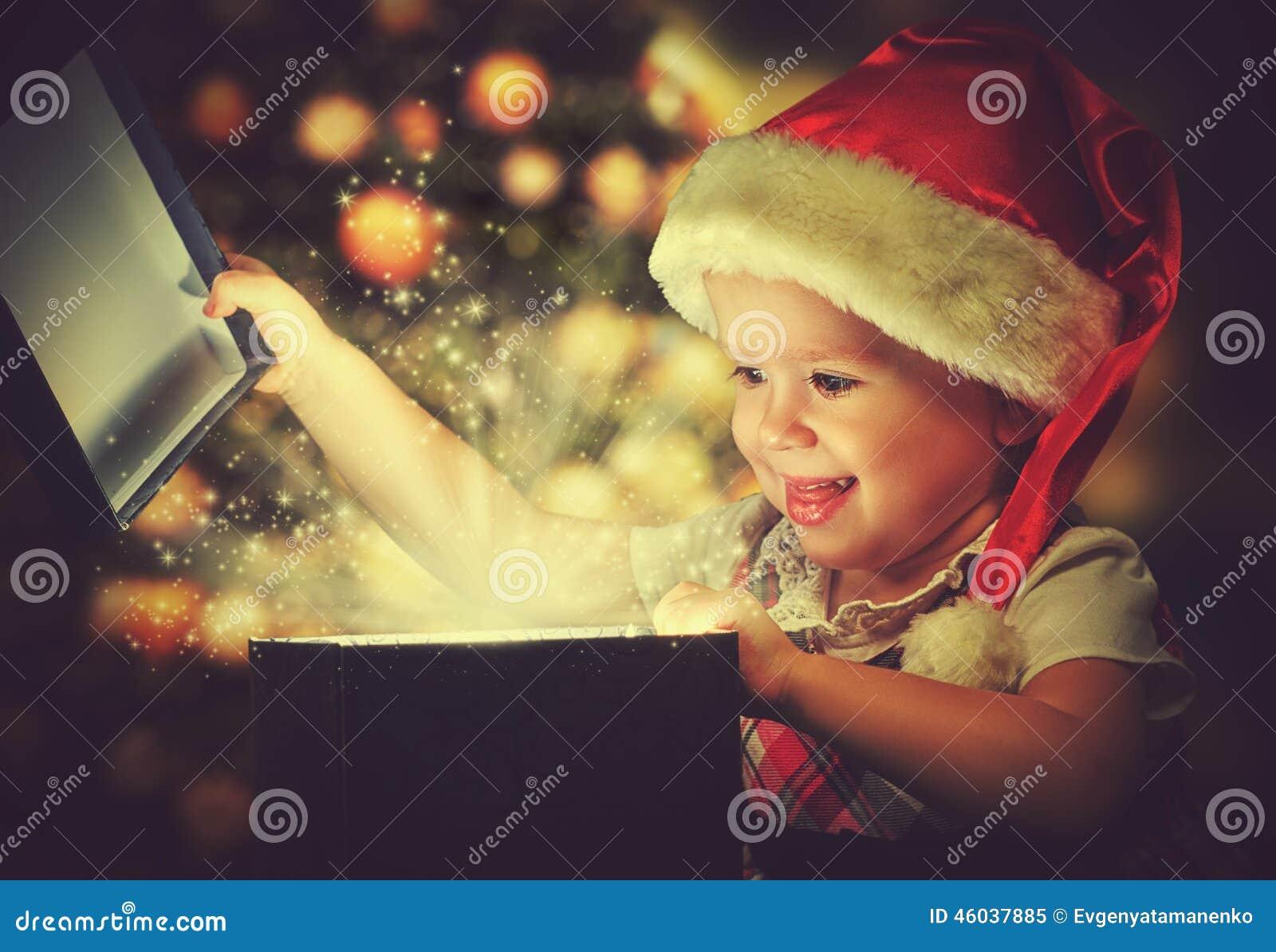 Christmas miracle, magic gift box and child baby girl