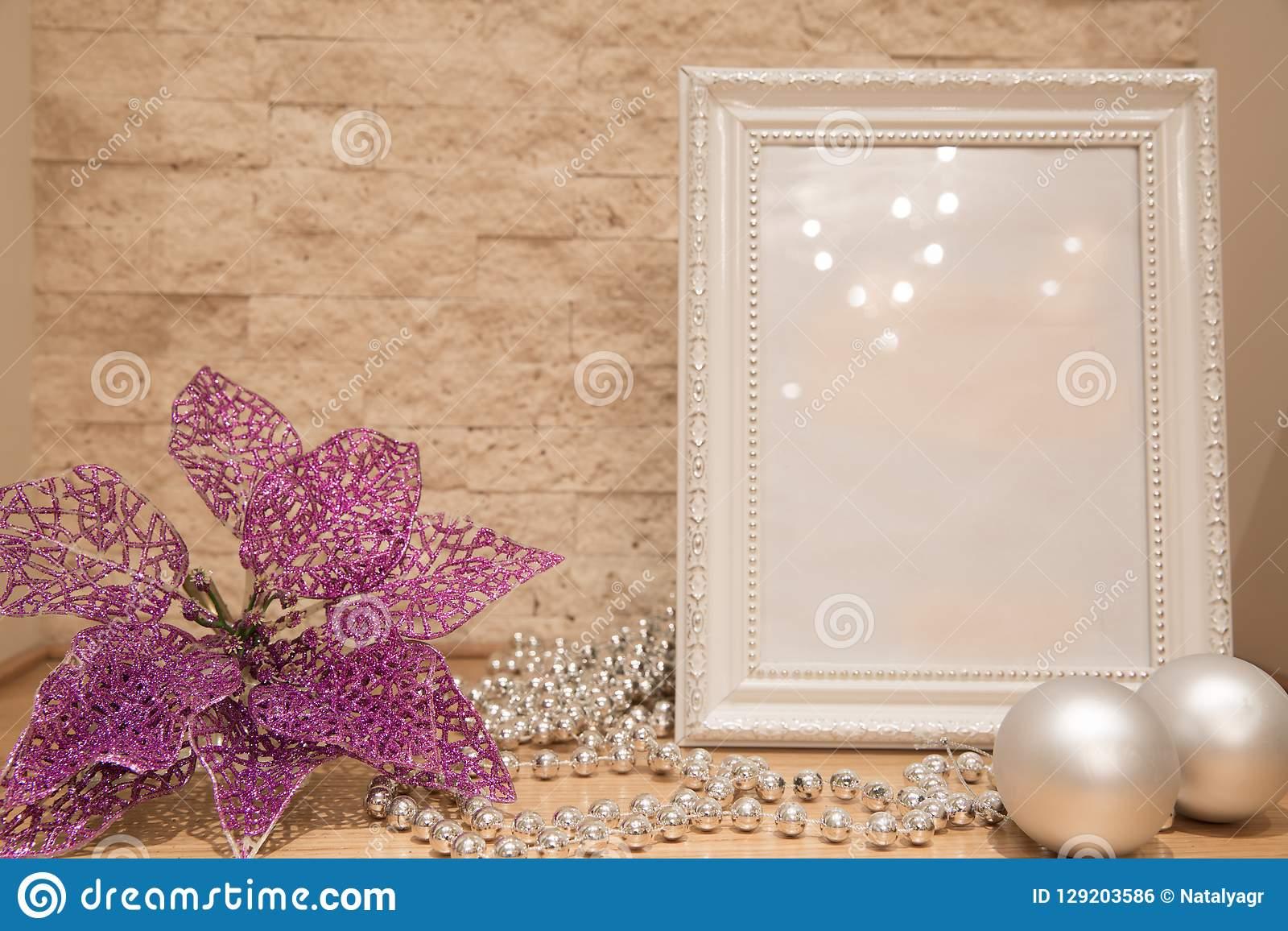 Christmas mock up, silver beads, Christmas balls, flowers decoration and brick wall background. Copy space.