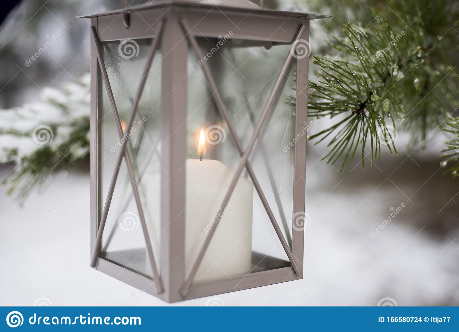 Christmas Mood With Outdoor Candle Holder With Burning Candle And Green Branches Covered With Snow On Background Stock Photo Image Of Rustic Season 166580724