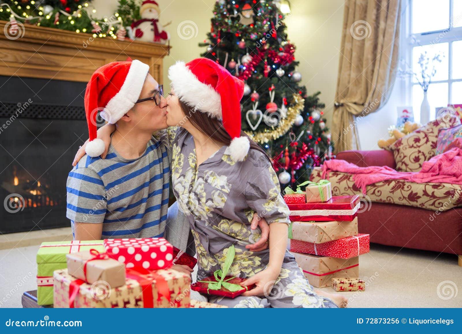 Christmas Morning Kiss Stock Photo 72873256 - Megapixl