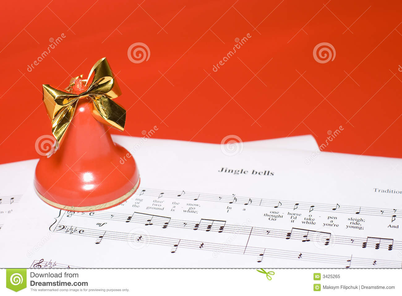 color festive christmas background bell standing on notes of christmas ...