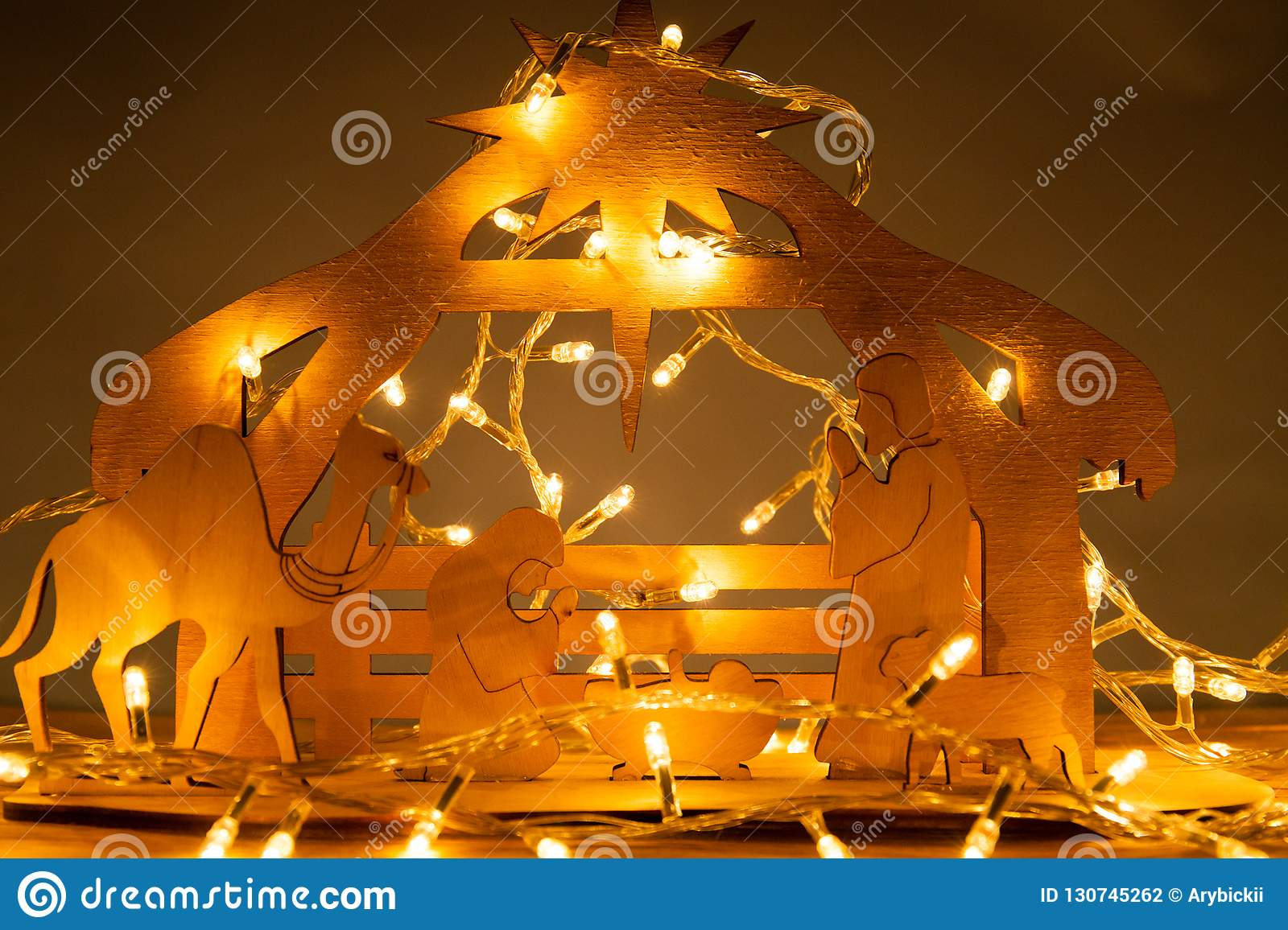 Christmas Nativity Scene of baby Jesus in the manger with Mary and Joseph in silhouette surrounded by the animals