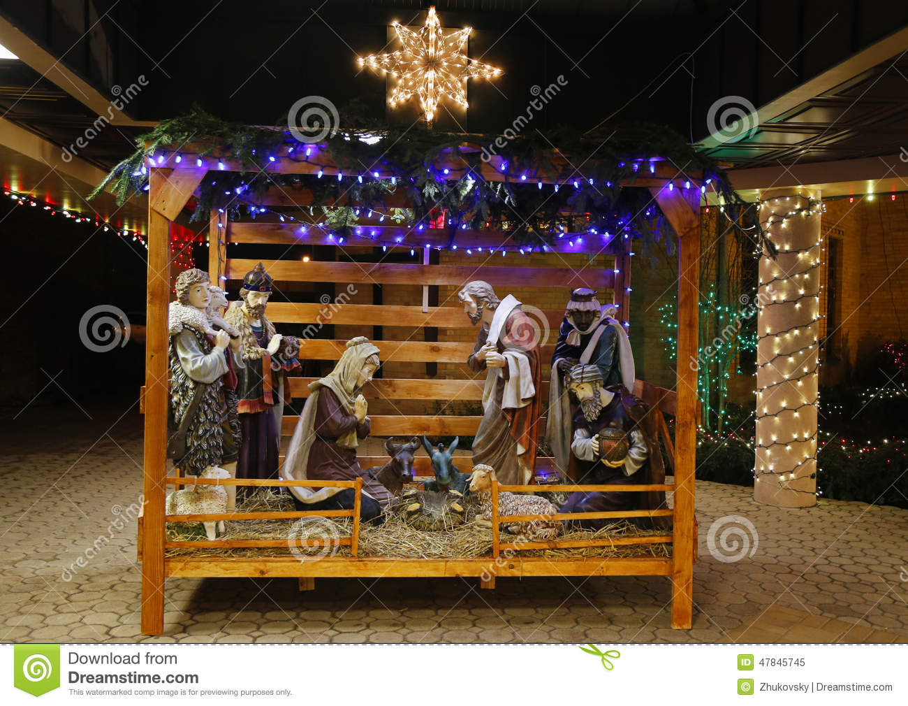 christmas nativity scene with three wise men presenting gifts to