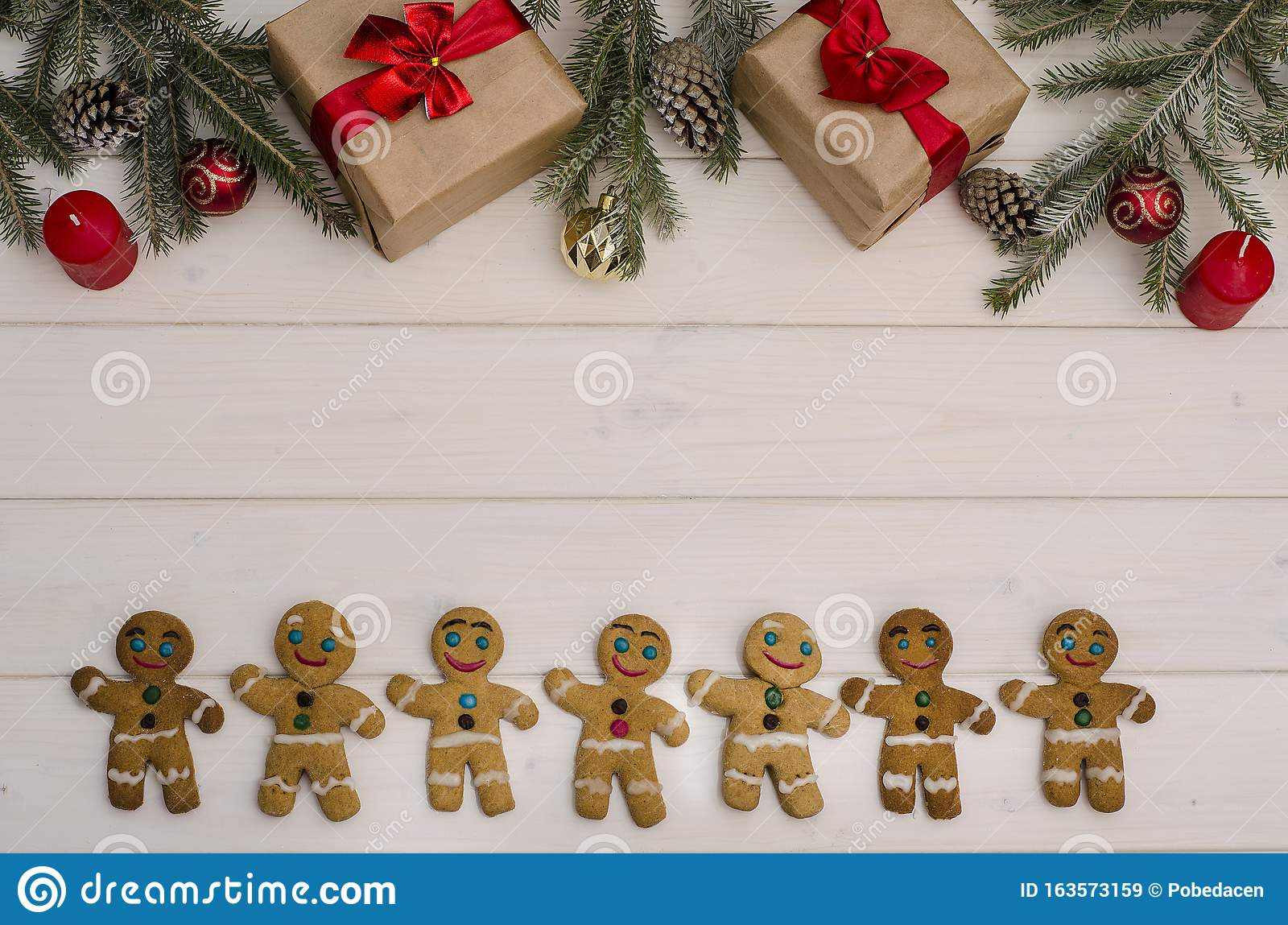Christmas And New Year Background Composition Of Gifts Christmas Tree Decorations And Branches Cones And Gingerbread Men With Stock Image Image Of Season Evergreen 163573159
