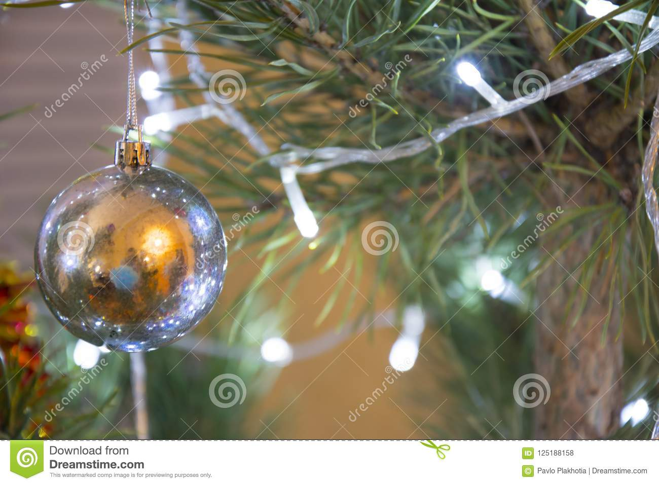 christmas or new year background decorated pine tree closeup