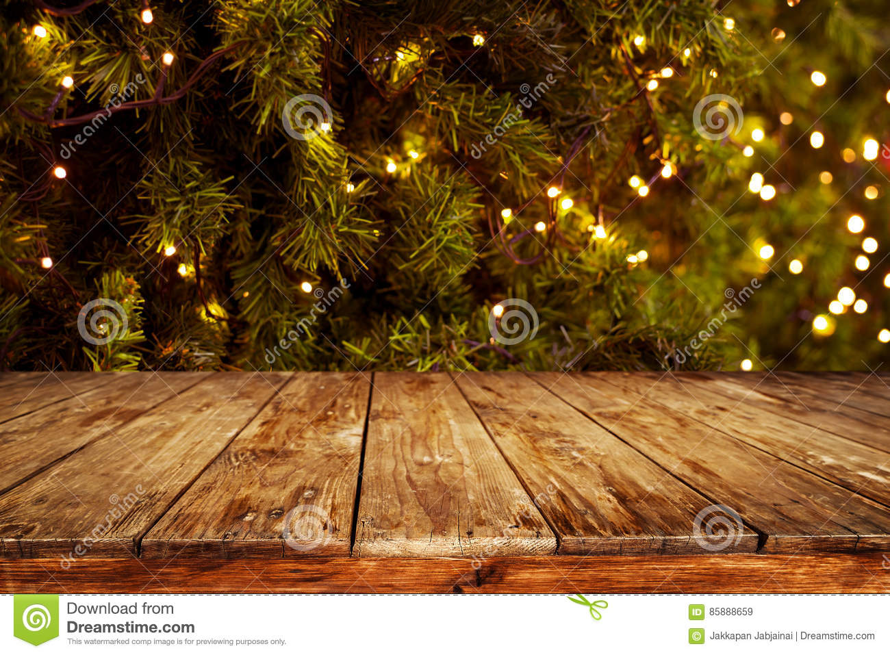 Christmas and new year background with empty dark wooden deck table download christmas and new year background with empty dark wooden deck table over christmas tree and aloadofball Gallery