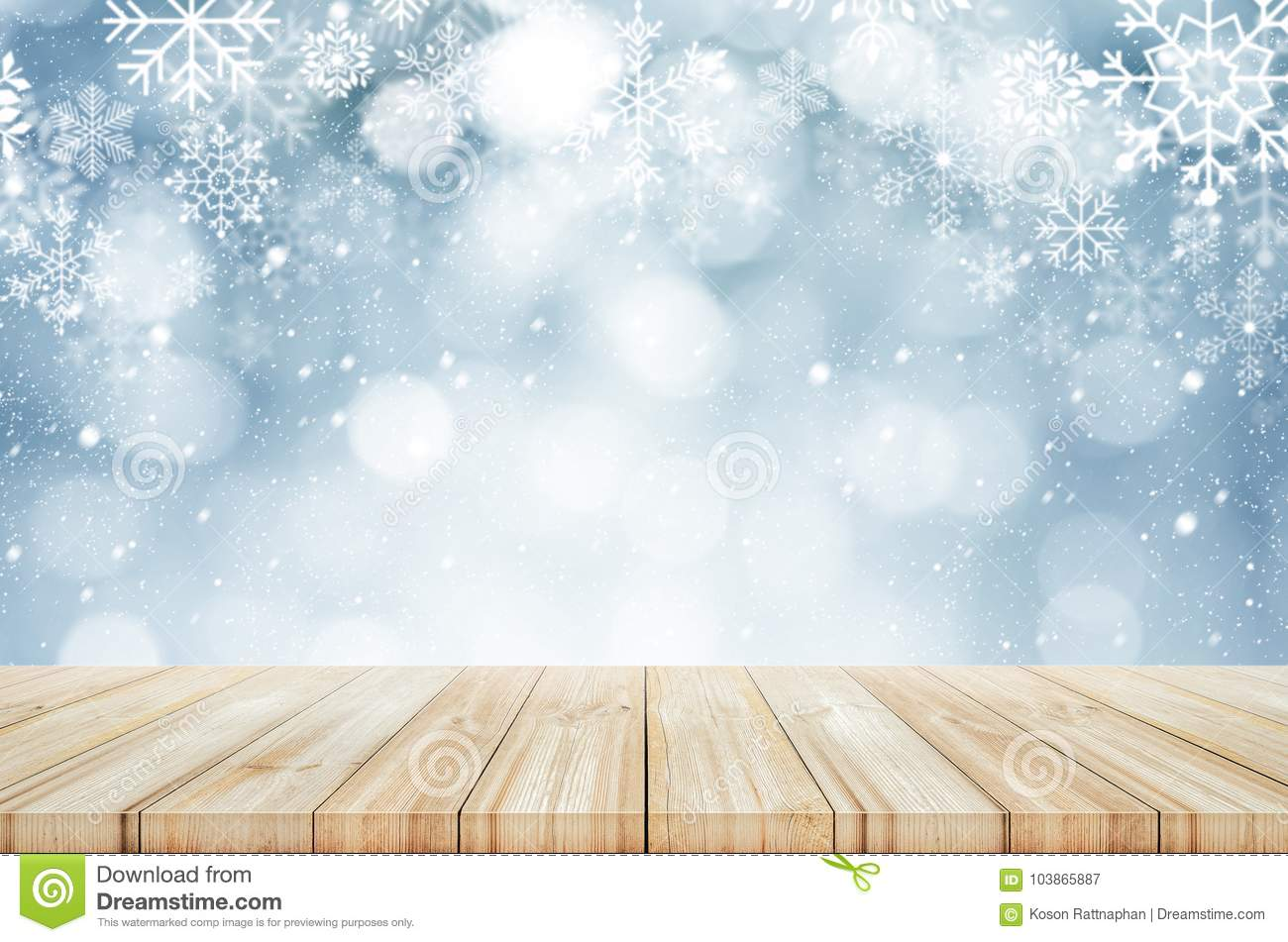 christmas and new year background wooden table with winter snow